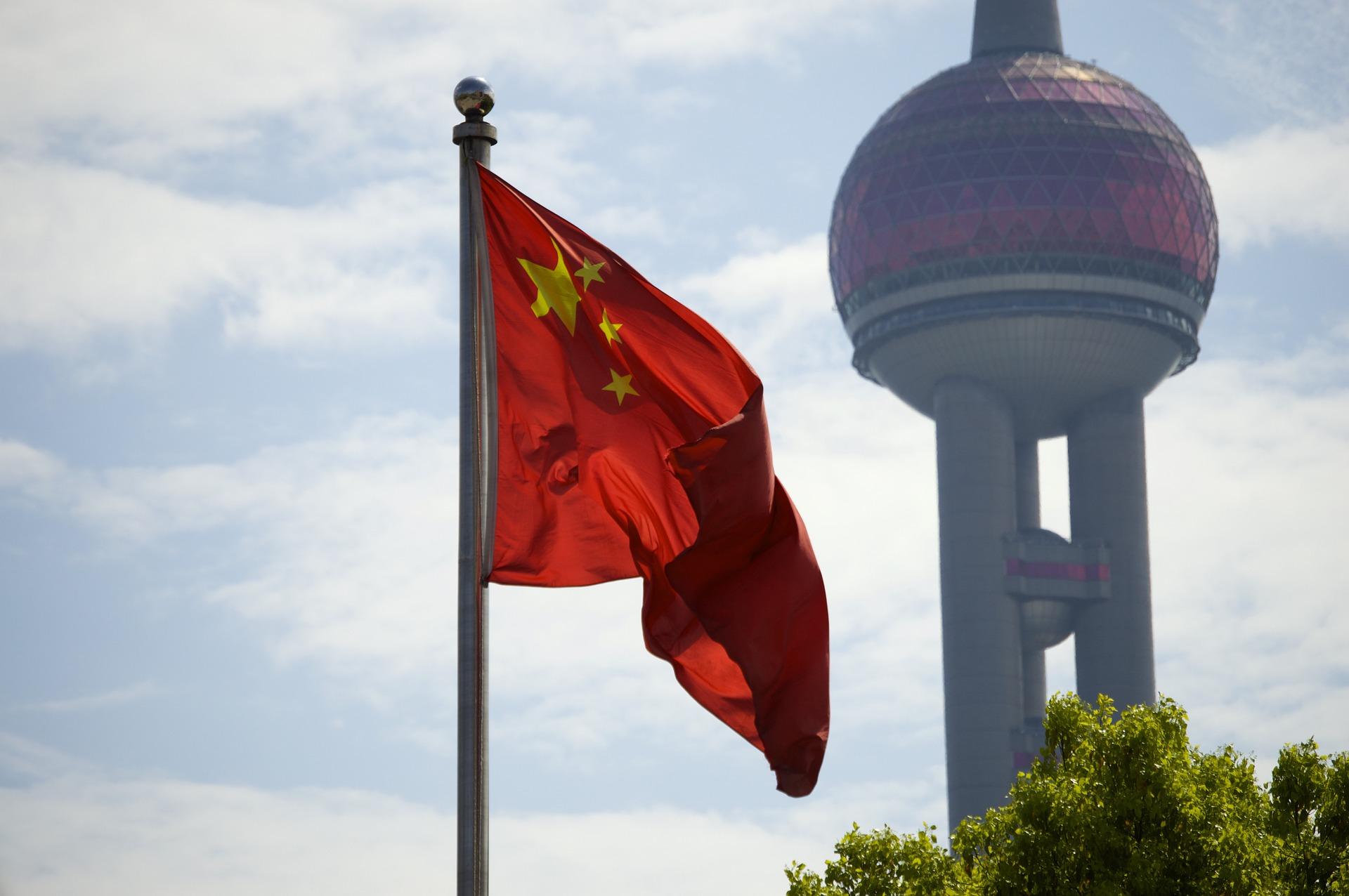 A flag on china next to Shanhai TV Tower
