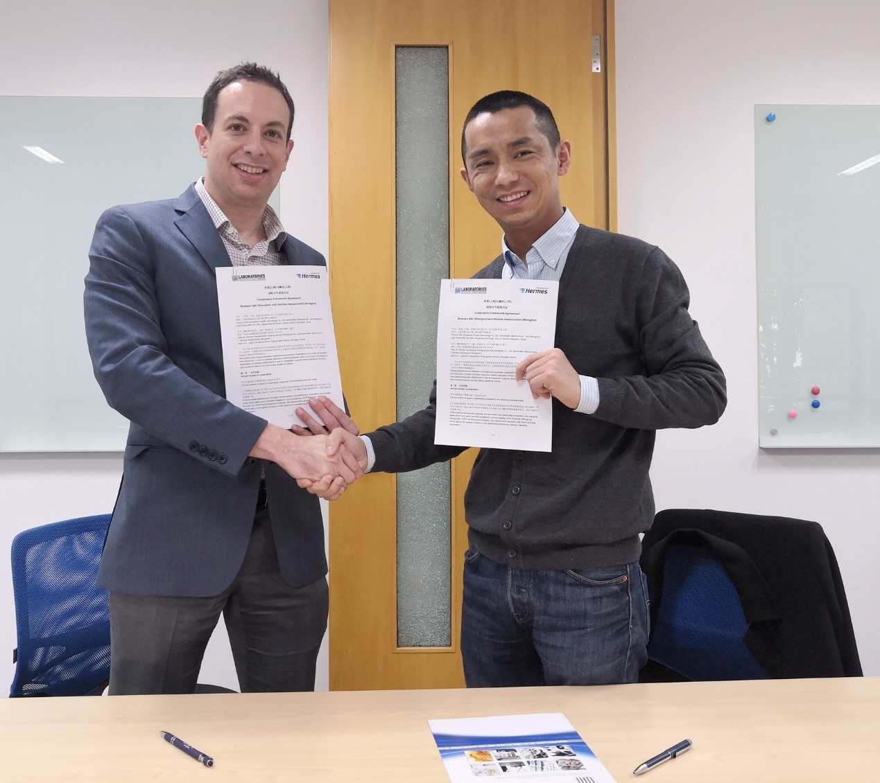 QAI and Hansecontrol shaking hands on Signed Agreement